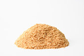 Close-up and pile of sawdust on white background.