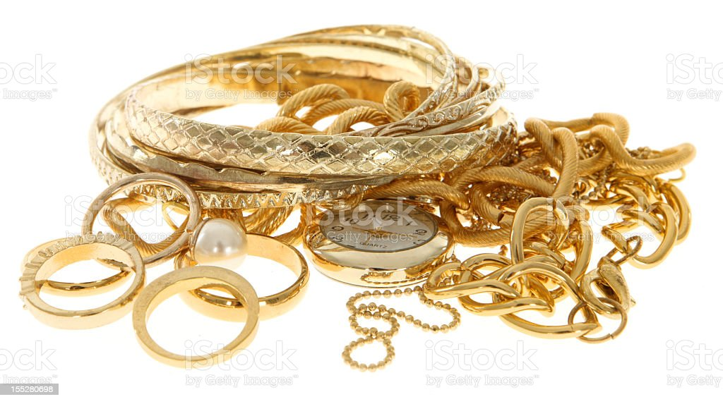 A pile of scrap gold jewelry on a white background stock photo