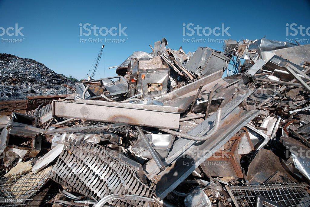 A pile of scrap metal in a junkyard royalty-free stock photo