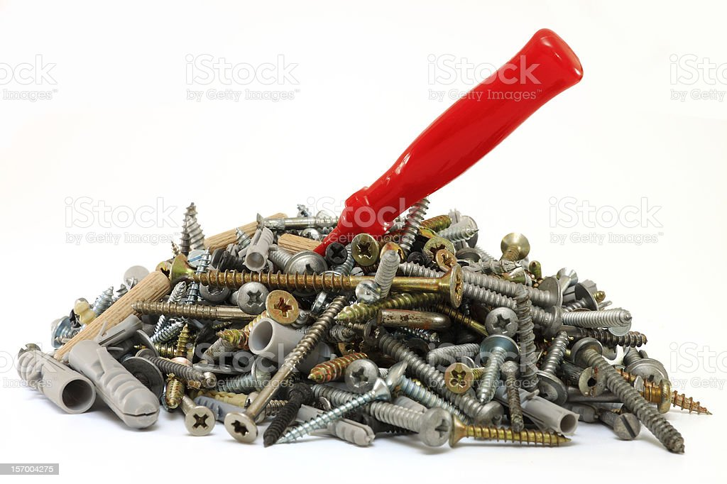 Pile of screws with a screwdriver in it royalty-free stock photo