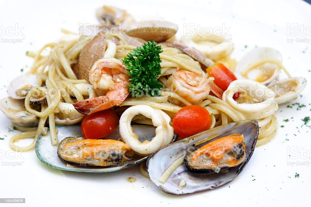 Pile of seafood pasta with clams shrimp squid and more royalty-free stock photo