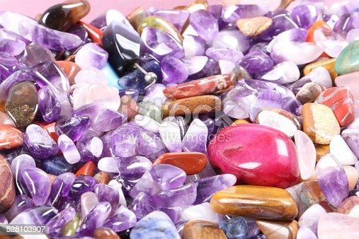 istock pile of semi precious jewelery stones closeup 528103907