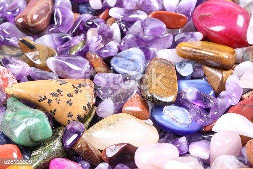 istock pile of semi precious jewelery stones closeup 528103909