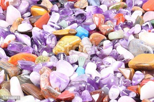 istock pile of semi precious jewelery stones closeup 528103911