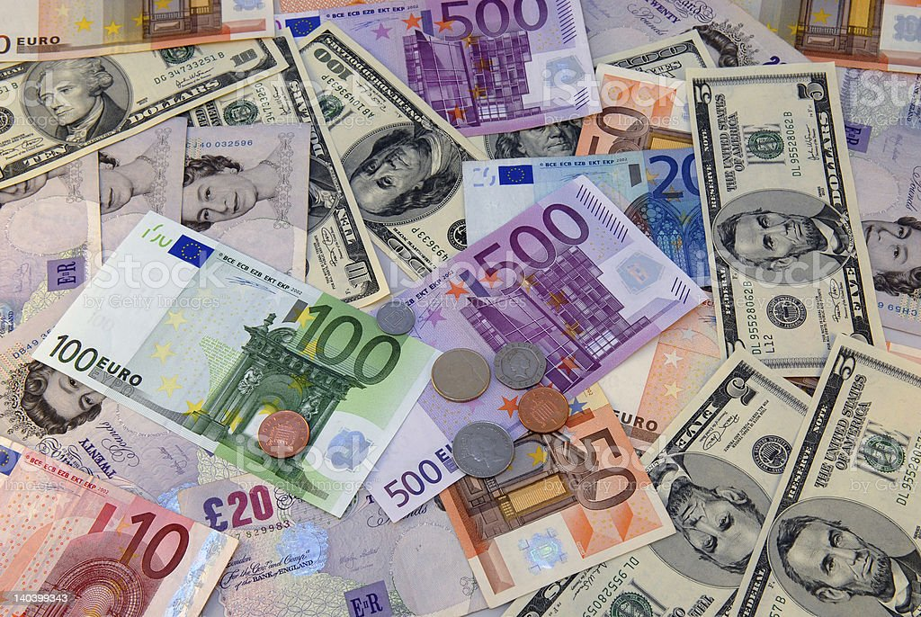 A pile of several different currencies from around the world stock photo