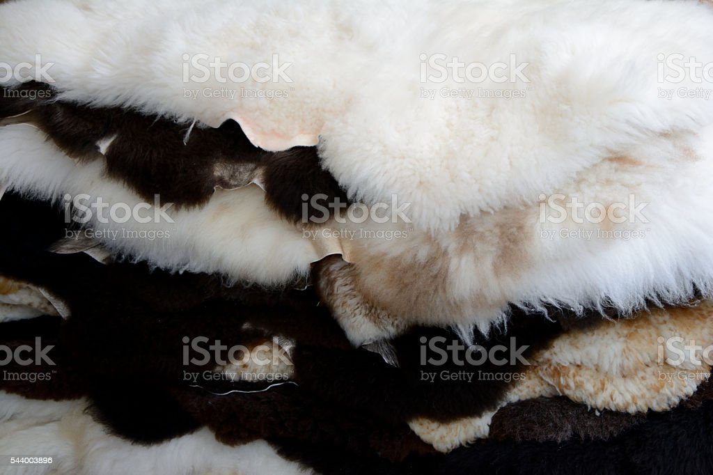 Pile of sheep leathers stock photo