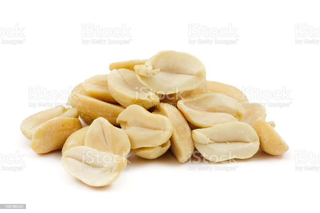 A pile of shelled peanuts on a white background stock photo
