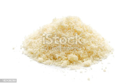 A small pile of grated parmesan cheese isolated on awhite background.
