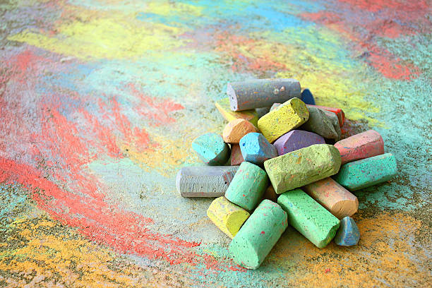 pile of sidewalk chalk - chalk drawing stock photos and pictures