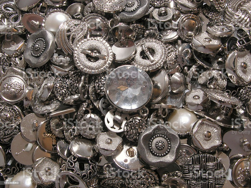 Pile of silver buttons royalty-free stock photo