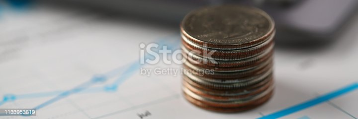 istock Pile of silver coins stand at financial graph papers 1133953619