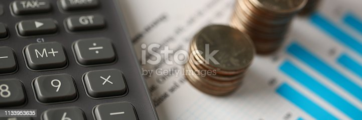 istock Pile of silver coins stand at financial graph papers 1133953635
