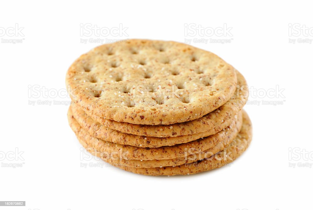 A pile of six crackers stacked on top of each other  stock photo