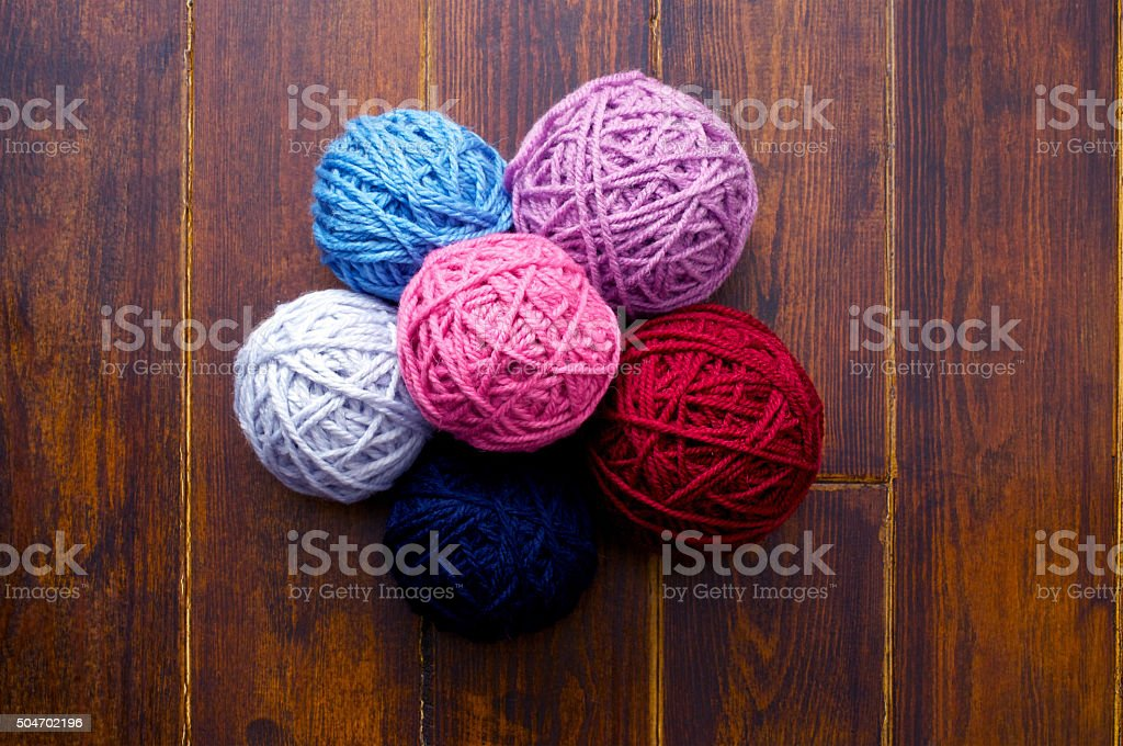 Pile of skeins over wooden background stock photo