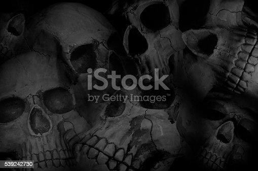 istock Pile of skulls background 539242730