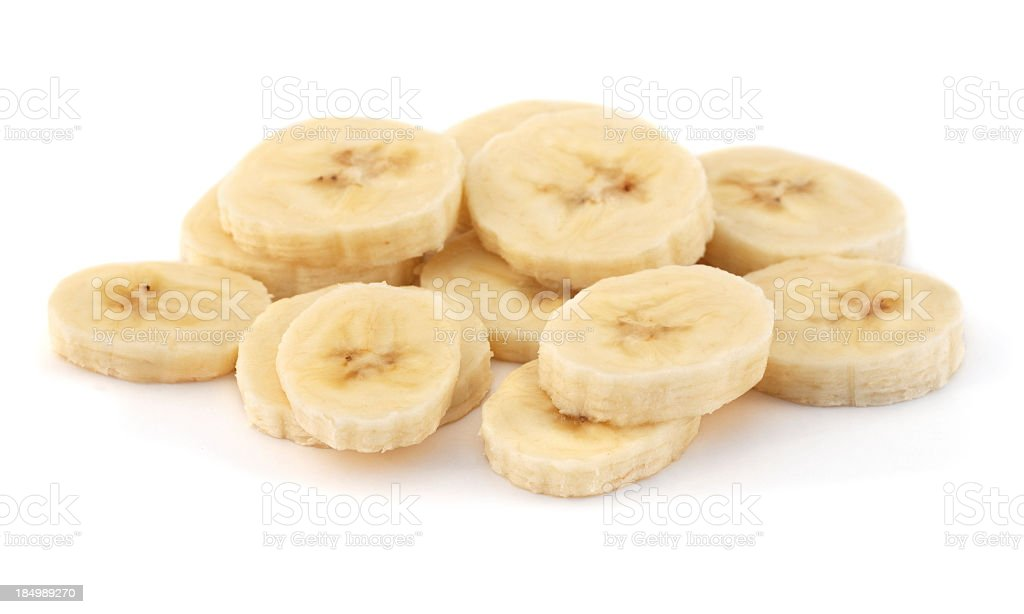 A pile of sliced ripe bananas on a white background stock photo