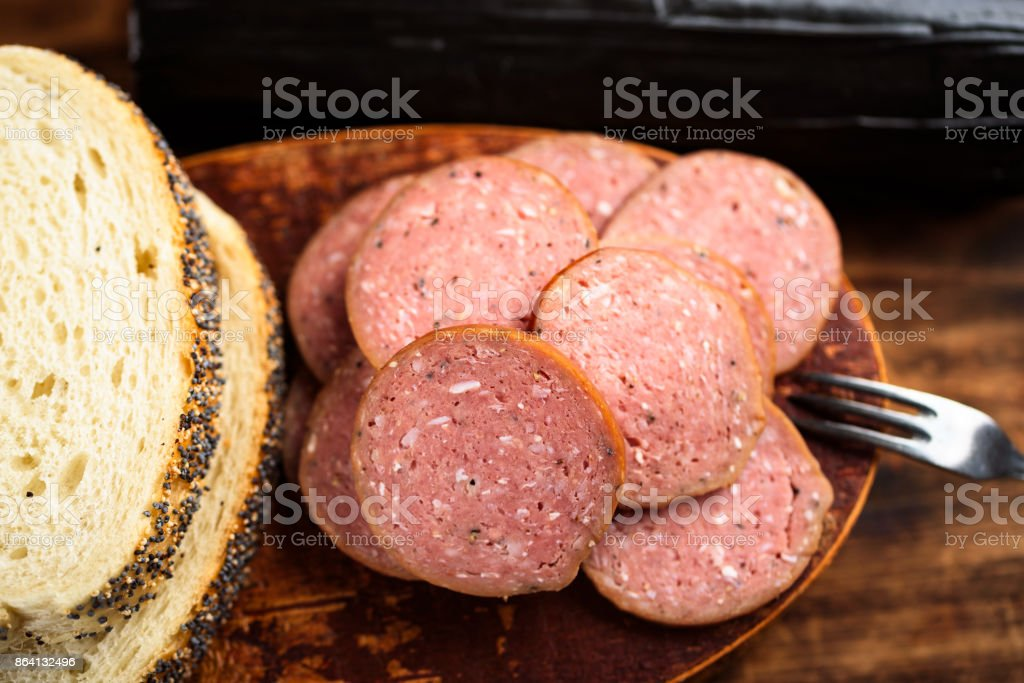Pile of sliced smoked sausages and bread royalty-free stock photo