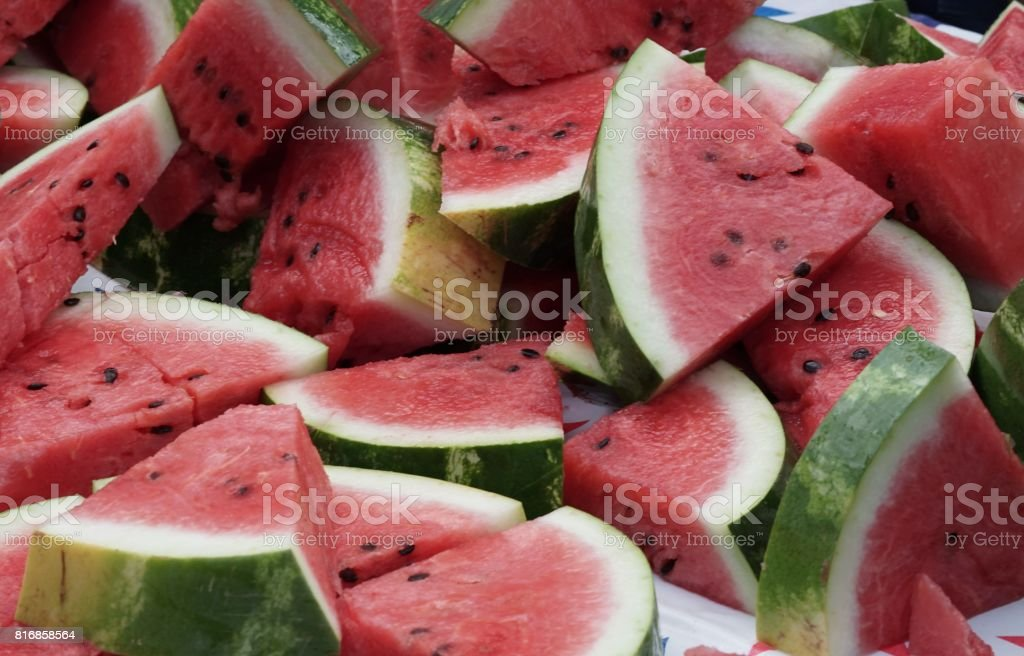 Pile of sliced watermelons stock photo