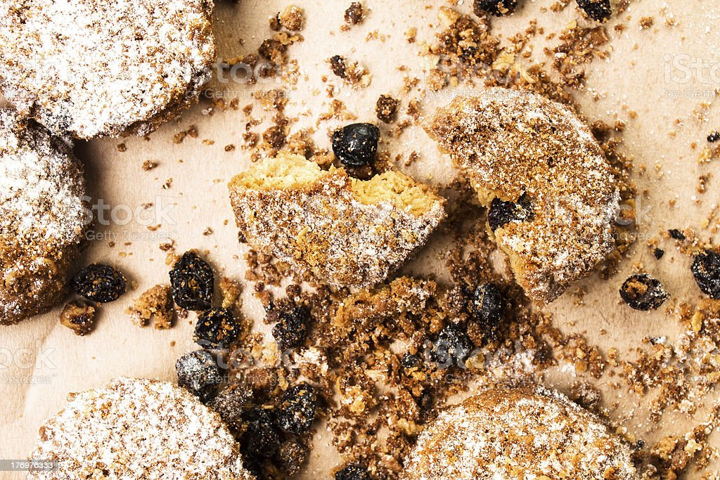 Pile of small cookies on brown paper parchament  background royalty-free stock photo