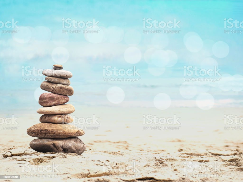 Pile of small stone as pyramid on the beach - Royalty-free Art Stock Photo