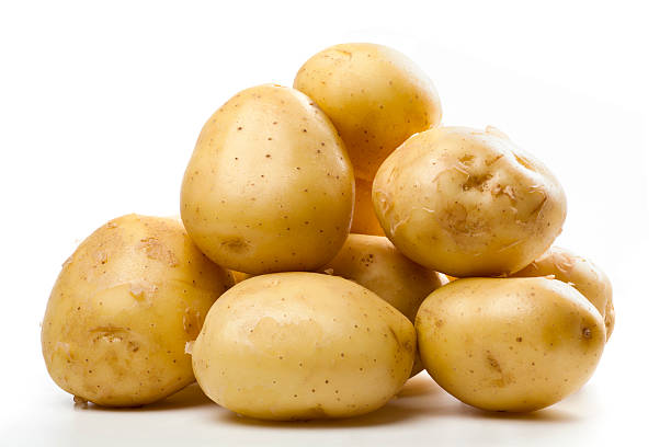 A pile of small yellow potatoes stock photo
