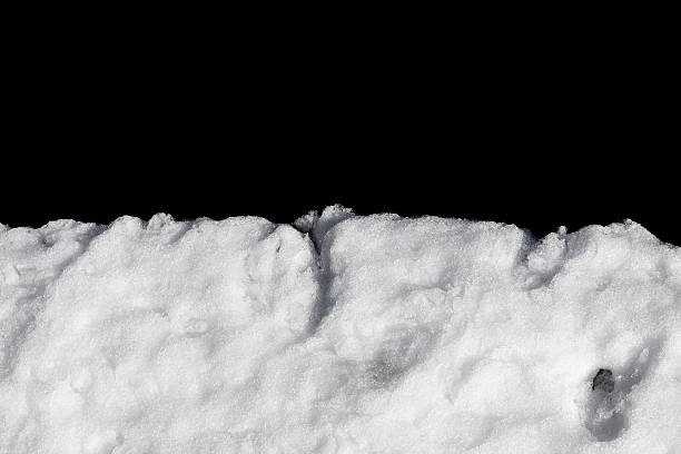pile of snow isolated on black - snow pile stock photos and pictures