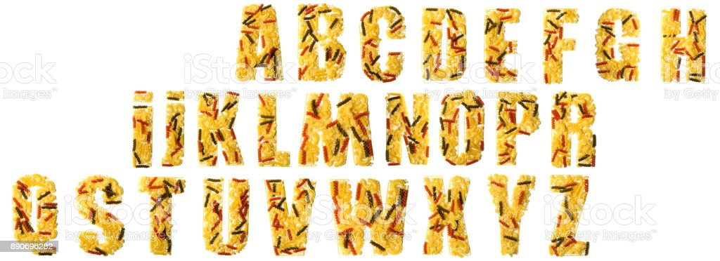 Pile of spaghetti forming a letters, all different shapes, colors and varieties stock photo