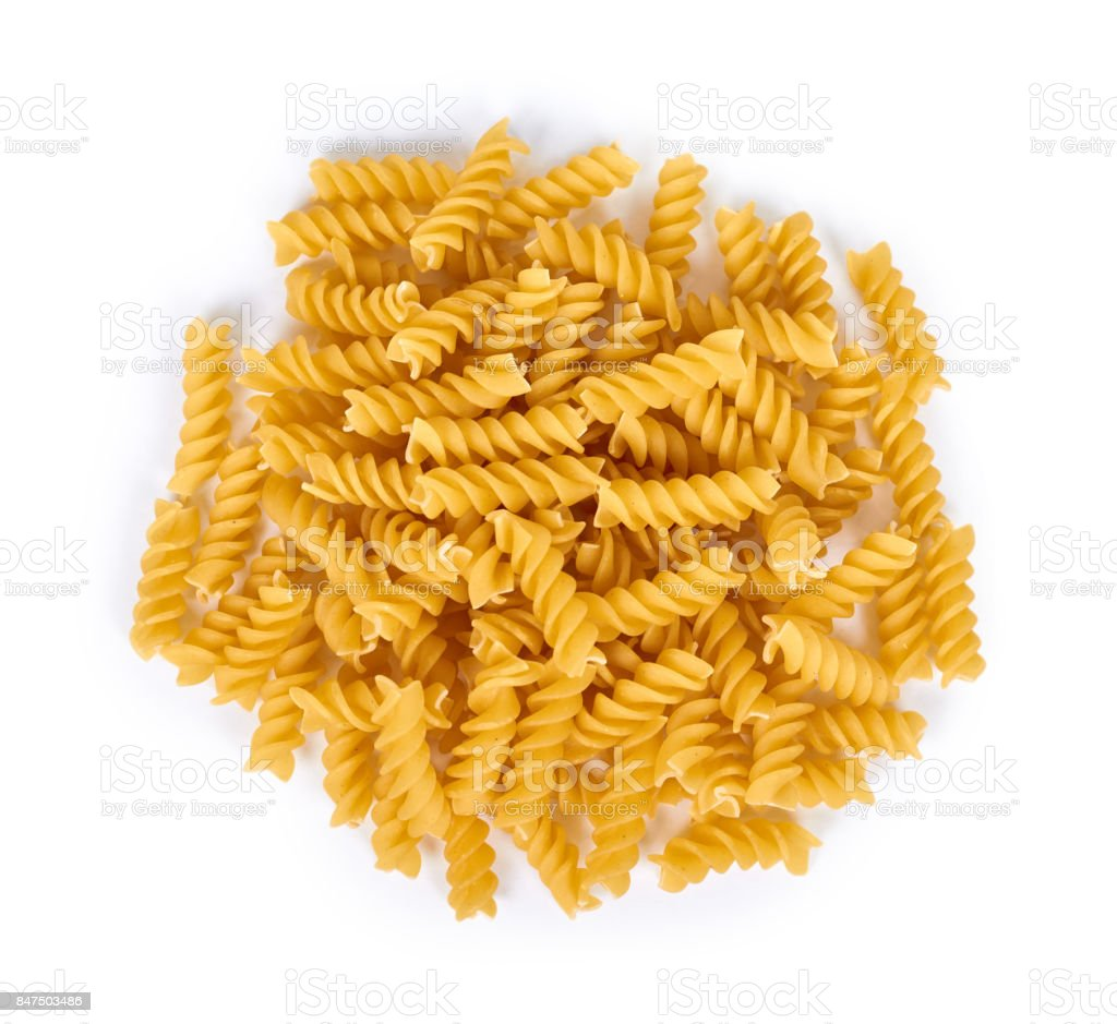 pile of spiral pasta isolated on white background stock photo
