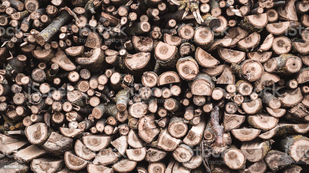 Pile of stacked firewood prepared for fireplace and boiler royalty-free stock photo