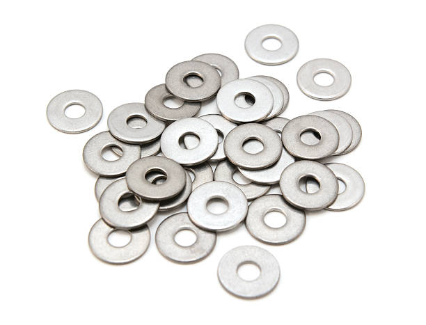Pile of stainless steel washers Pile of stainless steel flat washers, isolated on a white background washer fastener stock pictures, royalty-free photos & images