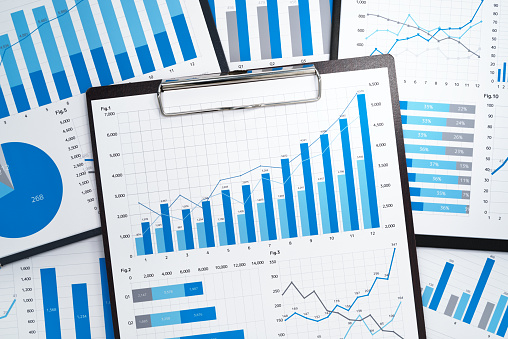 istock Pile of statistical business reports. 991837552