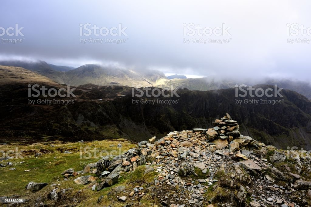 Pile of stone on the summit of Fleethwith Pike stock photo
