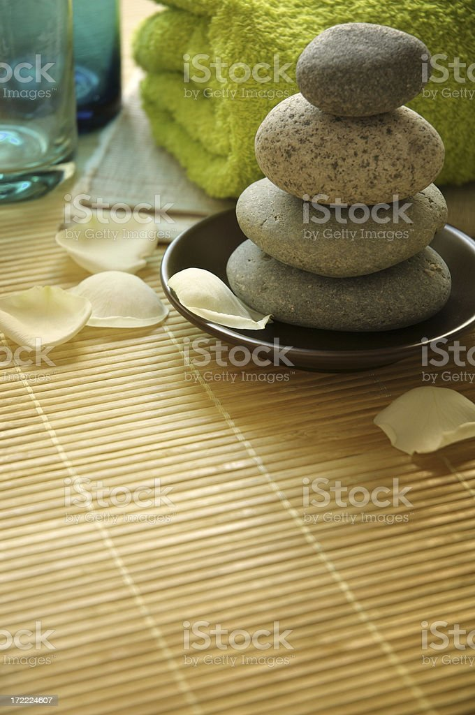 A pile of stones amongst other spa objects royalty-free stock photo