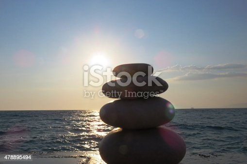 pile of stones at sunset