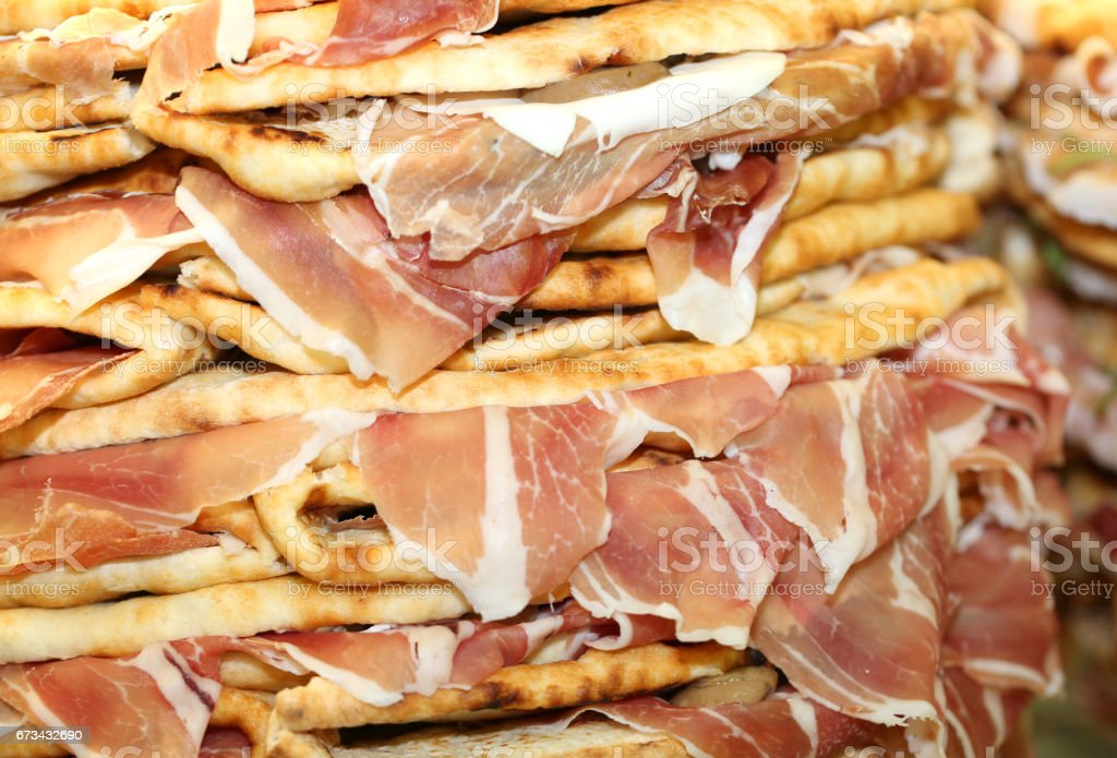 pile of stuffed tortillas with ham for sale in Italy stock photo