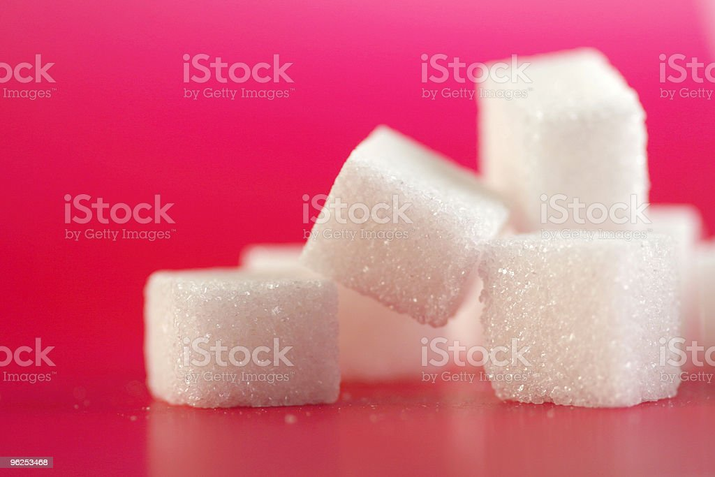 Pile of sugar cubes on pink background - Royalty-free Close-up Stock Photo