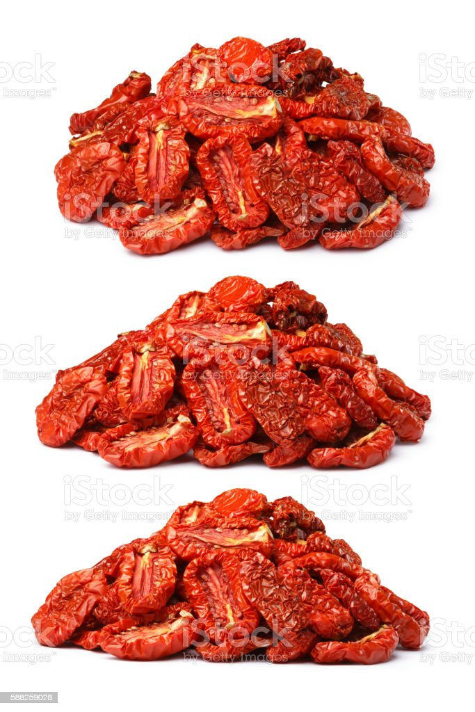 Pile of sundried tomatoes, three view angles, paths stock photo
