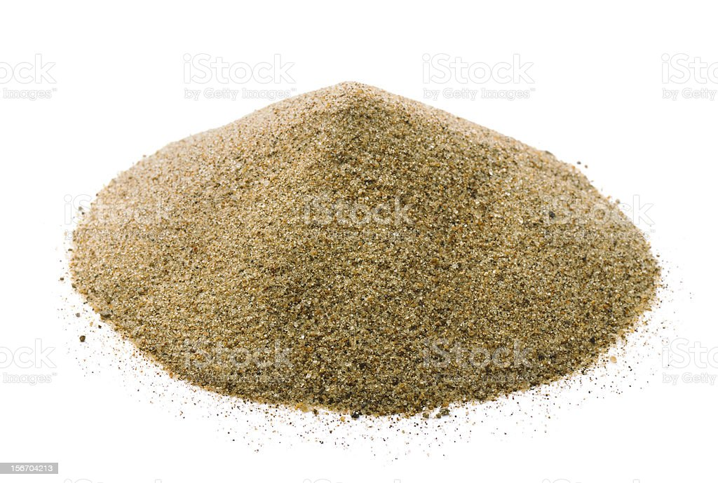 Pile of tan colored sand on a white background royalty-free stock photo