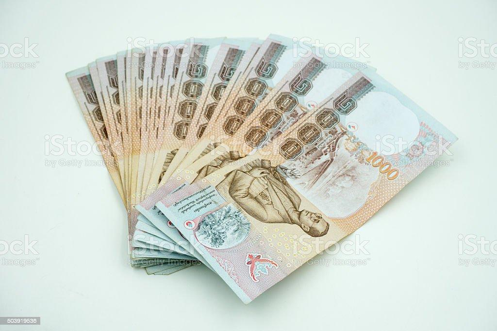 Pile of Thai money on white stock photo