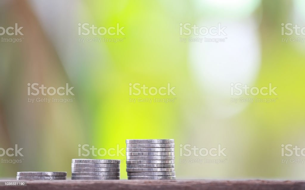 Pile of Thai silver coin to arranged in the form of bar graphs for...