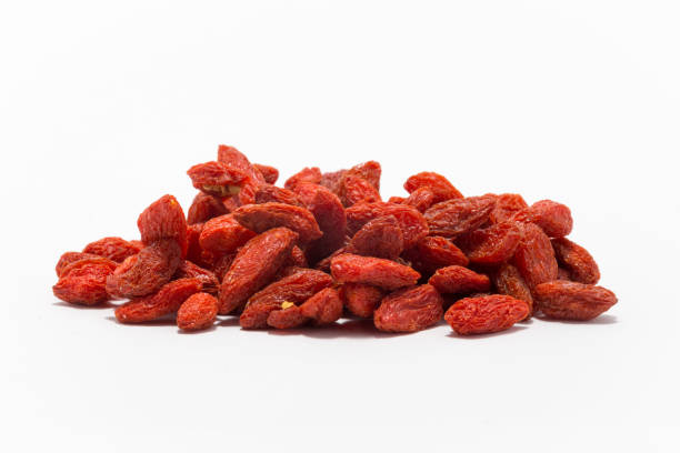 A pile of the superfood Goji berries on a white background stock photo