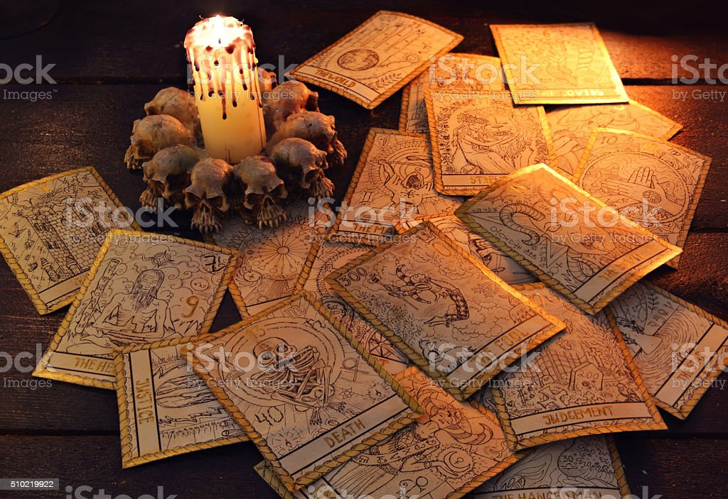 Pile of the tarot cards with candle stock photo