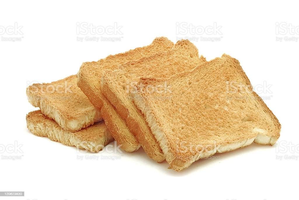 Pile of toasted bread on white background stock photo