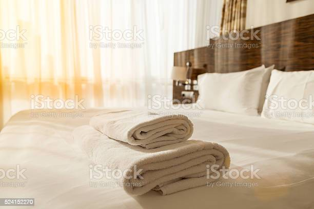 Pile of towels on the bed picture id524152270?b=1&k=6&m=524152270&s=612x612&h=2dqnjqkcgxh7h5eoy1ib176cdk7ijhf8dgxxxtotzcs=