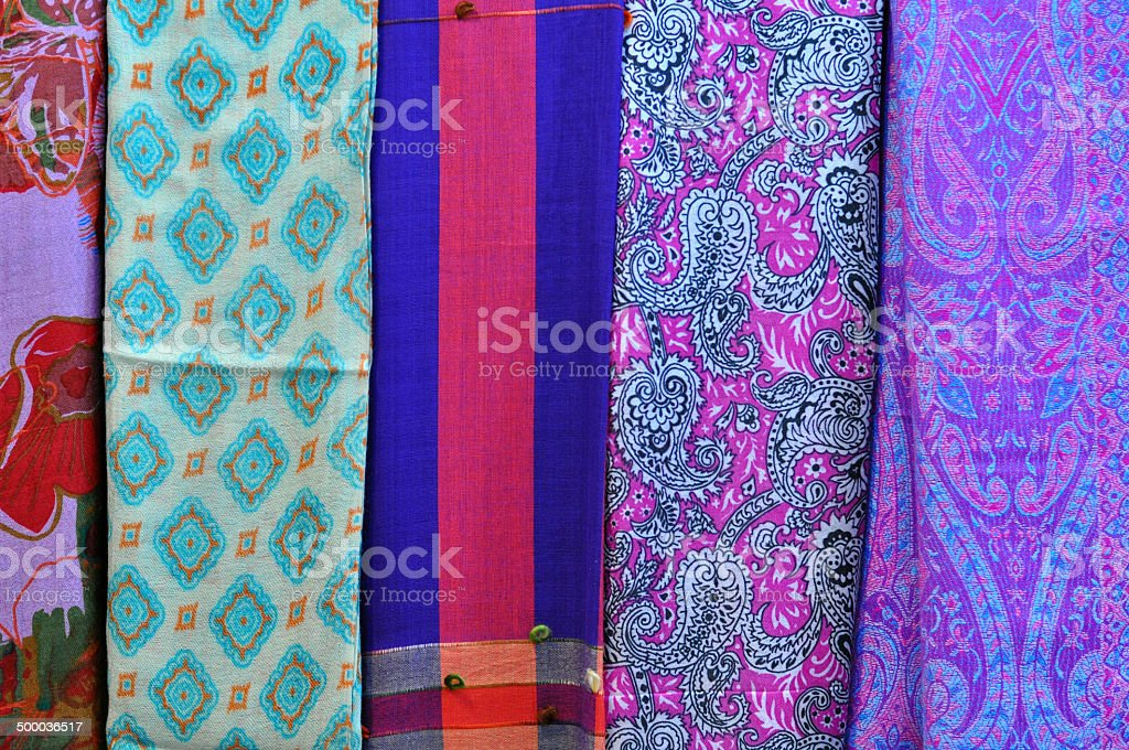 Pile of traditional colorful Arabic scarves stock photo