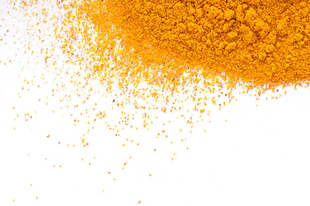 Pile of turmeric on white background stock photo