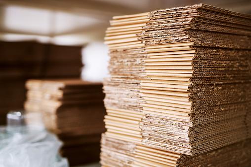 istock Pile of unmade boxes. Storage interior. 1072247352