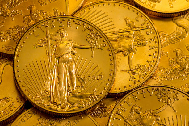 Pile of US Treasury Gold Eagle one ounce coins stock photo