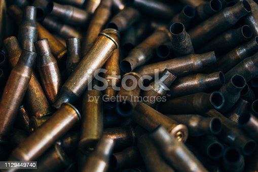 istock pile of used rifle cartridges 7.62 mm caliber, many empty bullet shells, assault rifle bullet shell, military background, top view 1129449740