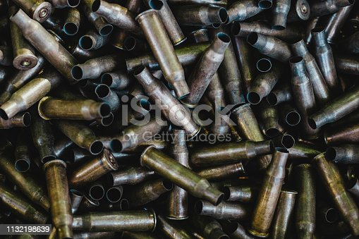 istock pile of used rifle cartridges 7.62 mm caliber, many empty bullet shells, assault rifle bullet shell, military background, top view 1132198639
